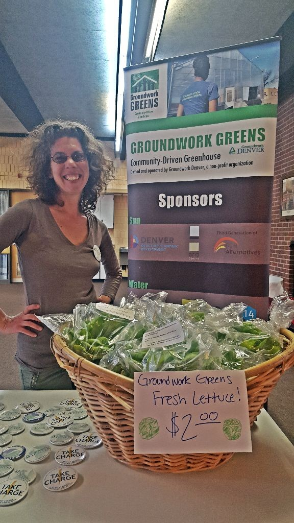 emily with greens and gh sign